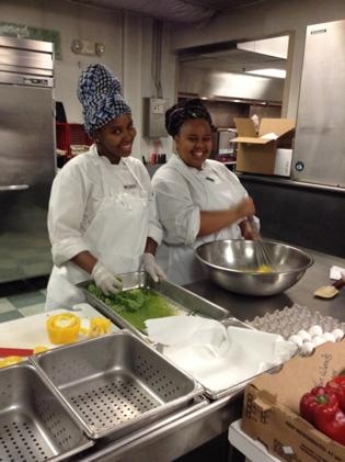 Tsholo and  Koketso in the  kitchen